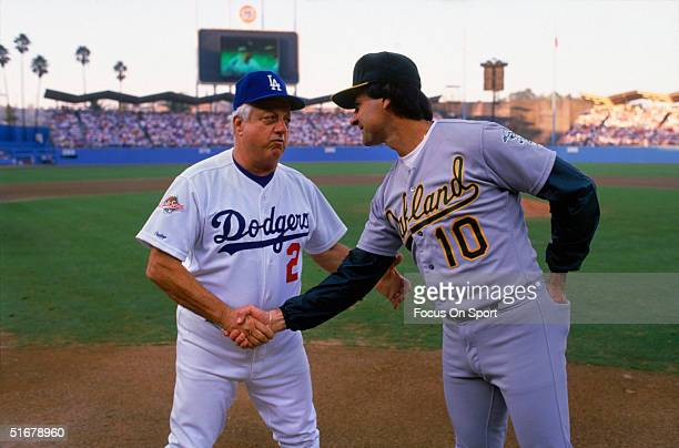 Managers Tommy Lasorda of the Los Angeles Dodgers and Tony LaRussa of the Oakland Athletics shake hands during the player introductions prior to Game...