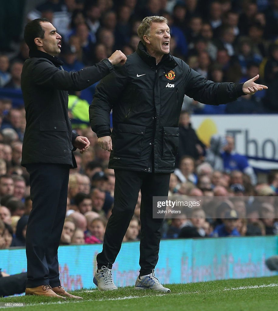 Managesr David Moyes of Manchester United and Roberto Martinez of Everton watch from the touchline during the Barclays Premier League match between Everton and Manchester United at Goodison Park on April 20, 2014 in Liverpool, England.