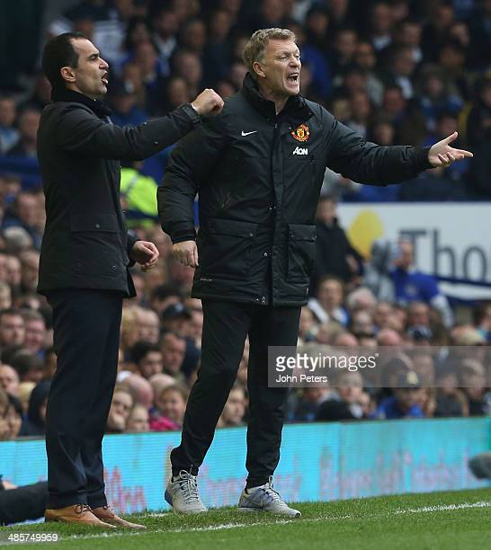 Managesr David Moyes of Manchester United and Roberto Martinez of Everton watch from the touchline during the Barclays Premier League match between...