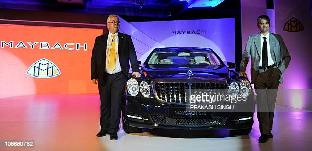 Managing Director and CEO of Mercedes Benz India Peter T Honegg and Mercedes Benz India Corporate Affairs Director Suhas Kadlaskar pose with the...