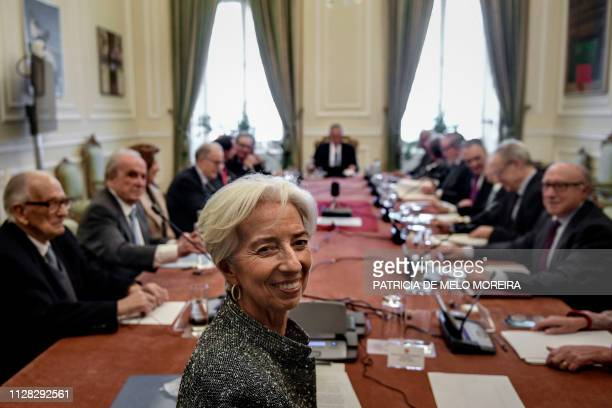 Managing director and chairwoman of the International Monetary Fund, Christine Lagarde , poses as she takes part in the Portuguese State Council at...