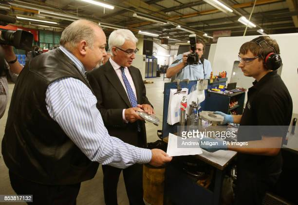 Managing director Archie Smith and worker Les Farron with Alistair Darling during a visit to Fife Fabrications in Glenrothes the day after the...