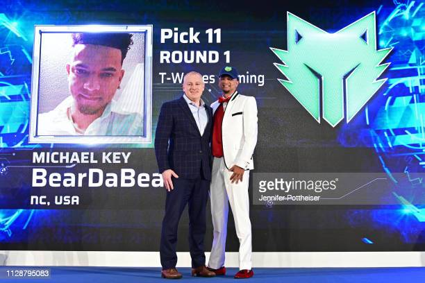 Managing Director Brendan Donohue poses for a photo with BearDaBeast after he is drafted number eleven overall by TWolves Gaming during the NBA 2K...