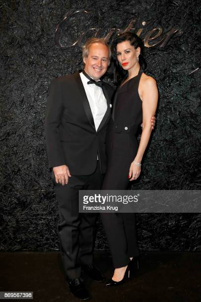 Managing Director Cartier Northern Europe Renaud Lestringant and Julia Stoschek wearing JUSTE UN CLOU Earrings and a JUSTE UN CLOU Bracelet attend...