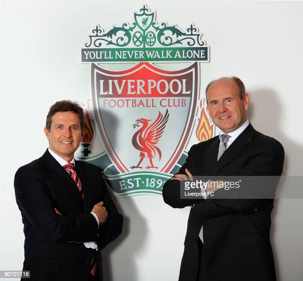 Managing Director Christian Purslow of Liverpool FC and Standard Chartered chairman John Peace pose in front of the club crest on signing a new four...