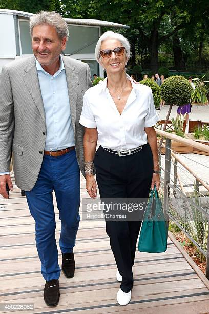 Managing Director Christine Lagarde and her husband Xavier Giocanti attend the Roland Garros French Tennis Open 2014 Day 14 on June 7 2014 in Paris...