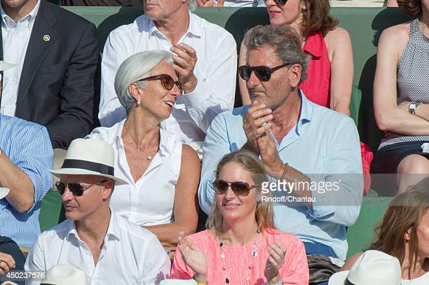Managing Director Christine Lagarde and her husband Xavier Giocanti attend the Roland Garros French Tennis Open 2014 Day 14 at Roland Garros on June...