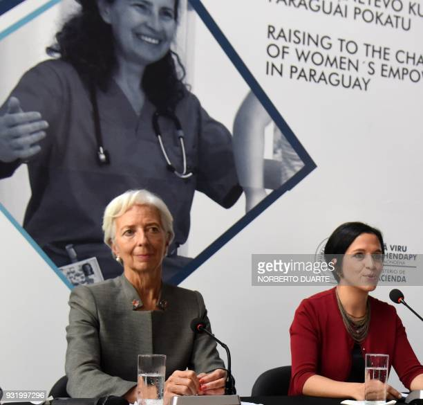 IMF Managing Director Christine Lagarde and Paraguay's Economy Minister Lea Gimenez delivering a speach during a press conference after a meeting...