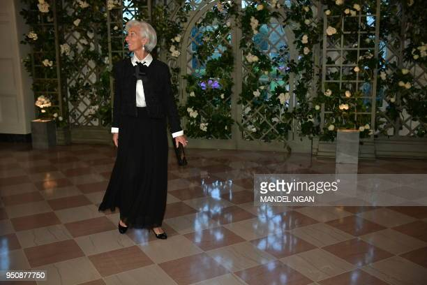 IMF Managing Director Christine Lagarde arrives in the Booksellers Area of the White House to attend a state dinner honoring French President...