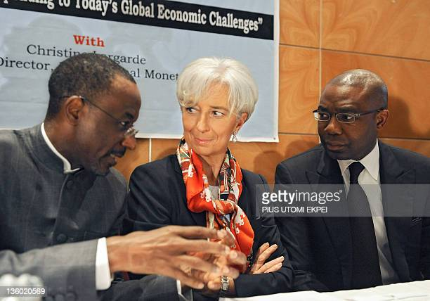 IMF Managing Director Christine Lagarde flanked by Nigeria's Central Bank Governor Lamido Sanusi Lamido and CEO Access Bank Aigboje AigImoukhuede...