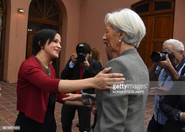 IMF Managing Director Christine Lagarde greets Paraguay's Economy Minister Lea Gimenez before a meeting with civil society women leaders in Asuncion...