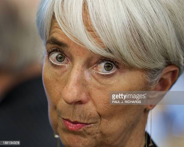 Managing Director Christine Lagarde listens as she is introduced before delivering remarks on development and governance in the Arab world December...