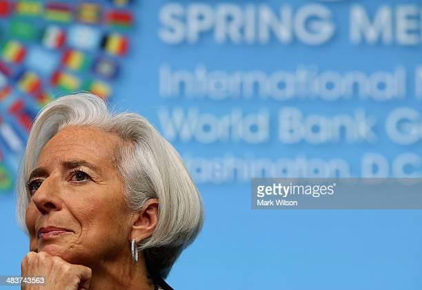 Managing Director Christine Lagarde listens questions during a media briefing at the IMF Headquarters on April 10 2014 in Washington DC Director...