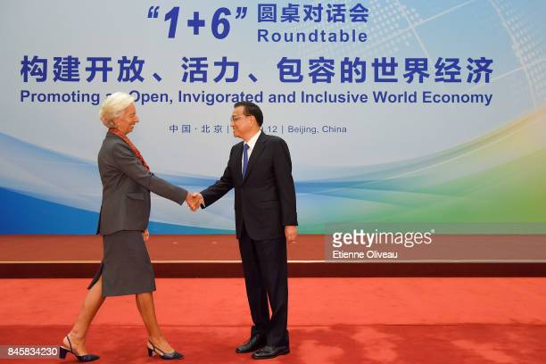 Managing Director Christine Lagarde of the International Monetary Fund shakes hands with Chinese Premier Li Keqiang before The 1+6 Round Table...