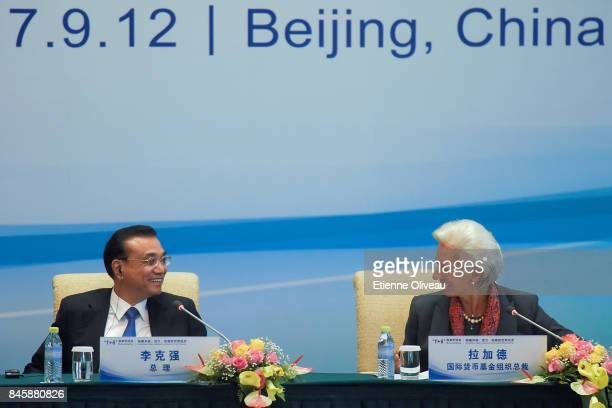 Managing Director Christine Lagarde of the International Monetary Fund and Chinese Premier Li Keqiang smile at each other during The 16 Round Table...