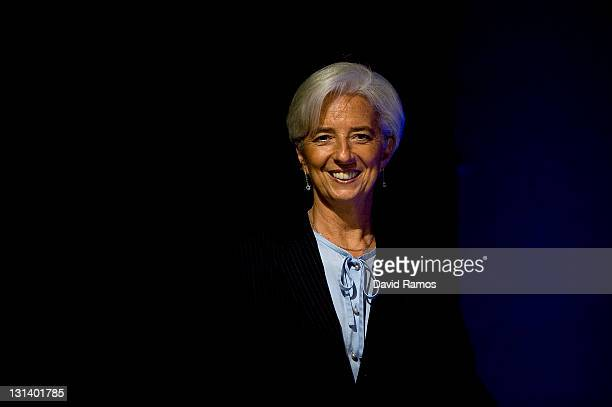 Managing Director Christine Lagarde smiles as she arrives for a press conference during the second day of the G20 Summit on November 4 2011 in Cannes...