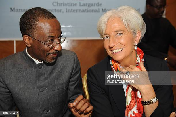IMF Managing Director Christine Lagarde talks with Nigeria's Central Bank Governor Lamido Sanusi Lamido during a roundtable on Africa's Future...