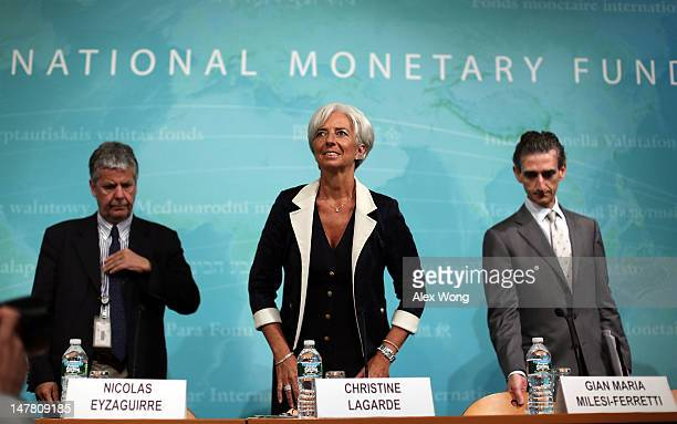 Managing Director Christine Lagarde Western Hemisphere Director Nicolas Eyzaguirre and US Mission Chief Gian Maria MilesiFerretti take their seats as...