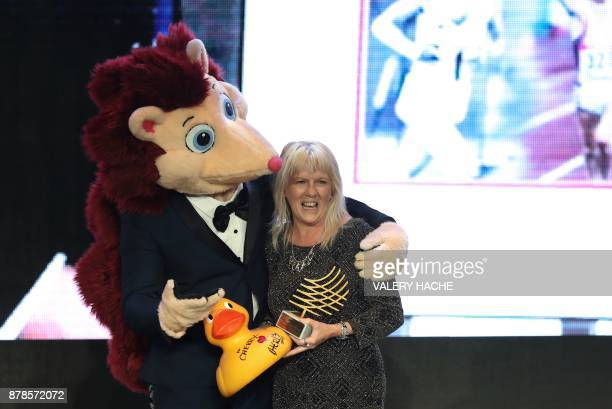 Managing director for the IAAF World Championships London 2017 Cherry Alexander poses with the trophy next to IAAF mascot Hero the hedgehog after...