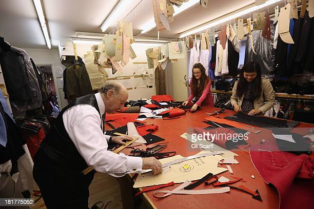 Managing Director Geoffrey Golding works with his staff in G.D. Golding tailors, who hold a Royal Warrant for services to the Royal Household, on...