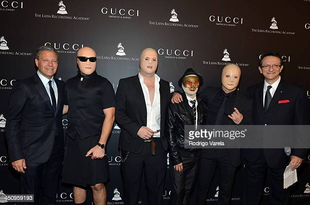 Managing Director Gucci Group Watches Jewelry Michael Benavente recording artists A Band of Bitches and president and CEO of the Latin Recording...