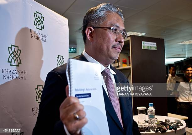 Managing Director Khazanah Nasional Berhad Azman Mokhtar poses with the Malaysia Airlines Restructuring plan durning a press conference at the...