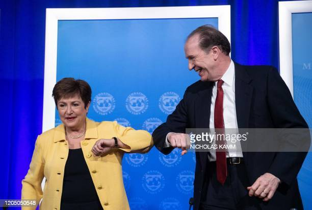 Managing Director Kristalina Georgieva and World Bank Group President David Malpass bump elbows at the end of a joint press briefing on COVID-19 in...