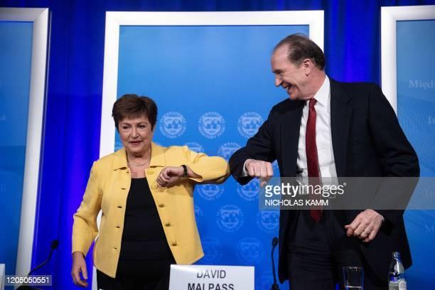 IMF Managing Director Kristalina Georgieva and World Bank Group President David Malpass bump elbows at the end of a joint press briefing on COVID19...
