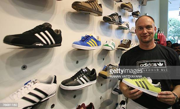 Managing Director of Adidas India Andreas Gellner poses in the newly launched 'adidas Originals' store in New Delhi 12 September 2007 Adidas opened...