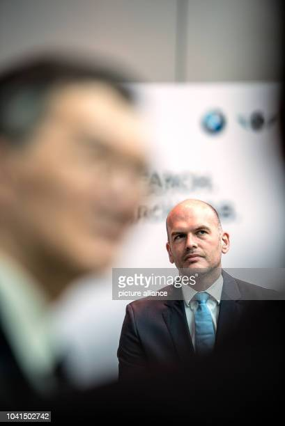 Managing Director of BMW Group Asia Axel Pannes attends the launch of a new electromobility research programme a joint venture between BMW Group and...