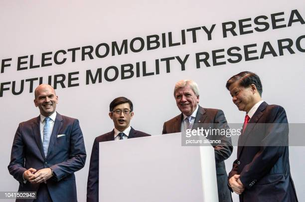 Managing Director of BMW Group Asia Axel Pannes Minister of State at Singapore_s Ministry of Trade and Industry Teo Ser Luck German Federal State of...