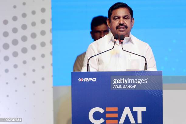 Managing Director of CEAT Tyres Anant Goenka along with Chief Minister of Tamil Nadu Edappadi K Palaniswami stand on stage during the inauguration of...