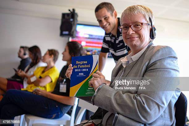 Managing Director of Centre for Acess to Football in Europe CAFE Joyce Cook pose for photo with a rulebook of football during 2014 FIFA World Cup...