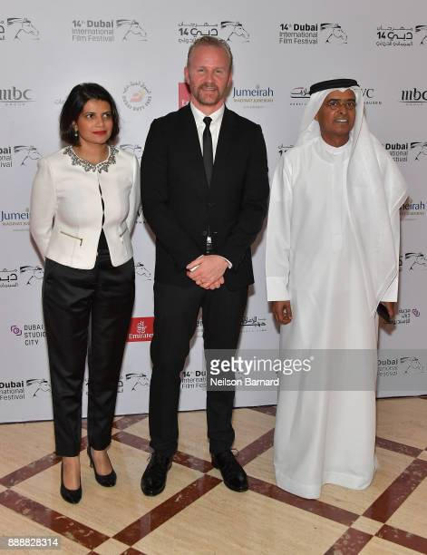 Managing Director of DIFF Shivani Pandya director Morgan Spurlock and DIFF Chairman Abdulhamid Juma attend the 'Super Size Me 2 Holy Chicken' red...
