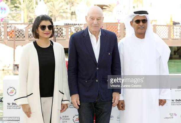 Managing Director of DIFF Shivani Pandya Sir Patrick Stewart and DIFF Chairman Abdulhamid Juma attend a photocall on day three of the 14th annual...