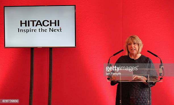 Managing Director of Hitachi Rail Europe, Karen Boswell OBE, speaks to guests during a visit to the Hitachi Rail Europe site on December 9, 2016 in...