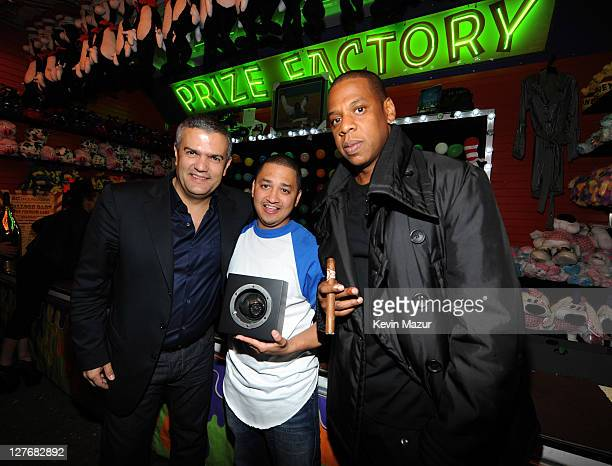 Managing director of Hublot Ricardo Guadalupe winner Macky Dancy and JayZ attend an evening of Making The Ordinary Extraordinary hosted by The Shawn...