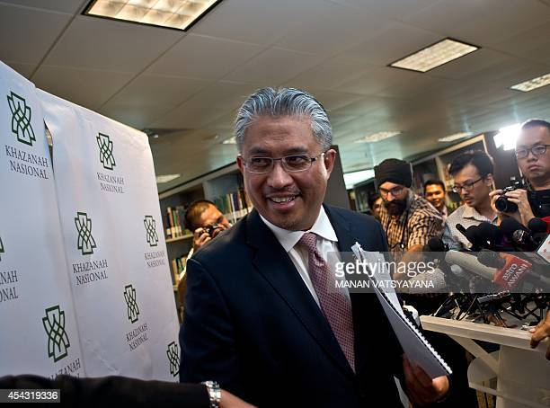 Managing director of Khazanah Nasional Berhad Azman Mokhtar leaves a press conference at the Khazana Nasional office in Kuala Lumpur on August 29...