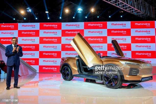 Managing Director of Mahindra and Mahindra Limited, Pawan Goenka , gestures as he speaks standing next to the newly launched Mahindra Funster...
