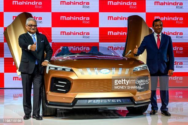 Managing Director of Mahindra and Mahindra Limited, Pawan Goenka , poses with the newly launched Mahindra Funster electric concept vehicle at the...