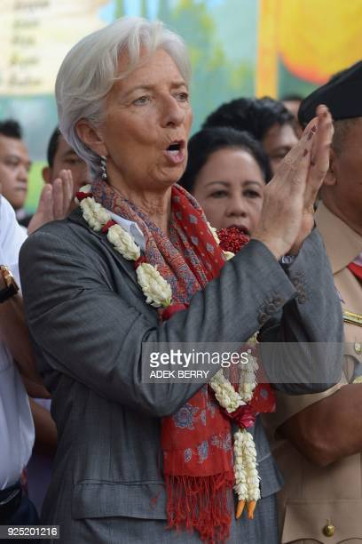 Managing Director of the International Monetary Fund Christine Lagarde applauds during a visit in Cilincing Jakarta on February 28 2018 Lagarde...