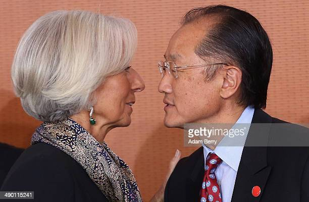 Managing Director of the International Monetary Fund Christine Lagarde and World Bank President Jim Yong Kim arrive for a meeting in the German...