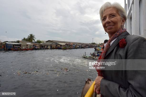 Managing Director of the International Monetary Fund Christine Lagarde looks at the Cilincing river in Cilincing Jakarta on February 28 2018 Lagarde...