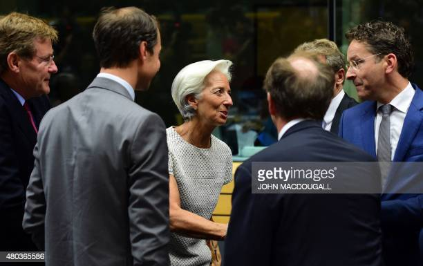 Managing Director of the International Monetary Fund Christine Lagarde greets President of the Eurogroup Jeroen Dijsselbloem prior to a meeting of...