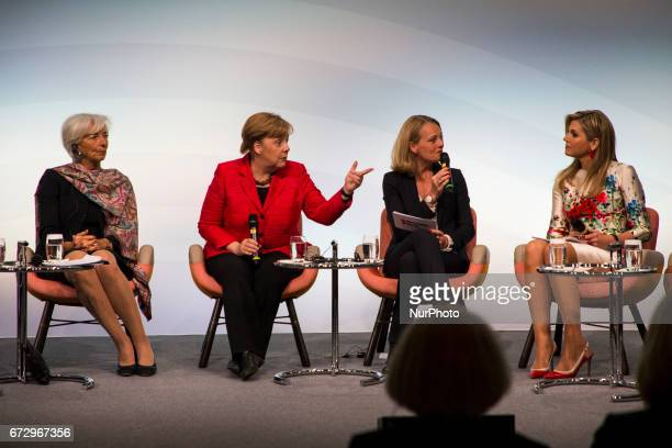 Managing Director of the International Monetary Fund Christine Lagarde , German Chancellor Angela Merkel , and Queen Maxima of the Netherlands attend...