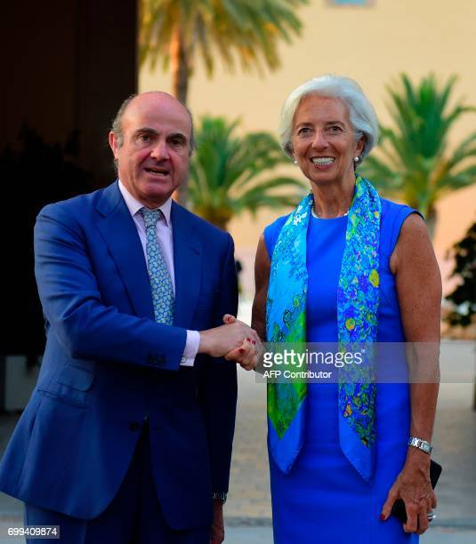Managing Director of the International Monetary Fund Christine Lagarde poses with Spanish Minister of Economy Luis de Guindos before a dinner of the...