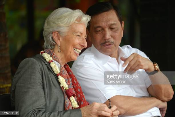 Managing Director of the International Monetary Fund Christine Lagarde sits next to Indonesia's Coordinating Minister for Maritime Affairs Luhut...