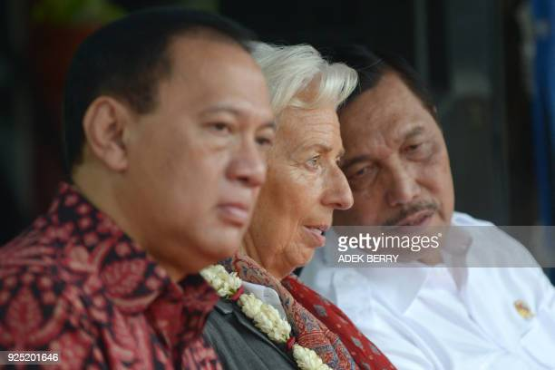 Managing Director of the International Monetary Fund Christine Lagarde sits between Indonesia's Coordinating Minister for Maritime Affairs Luhut...