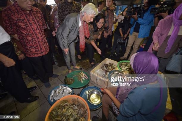 Managing Director of the International Monetary Fund Christine Lagarde tours a fish market during a visit in Cilincing Jakarta on February 28 2018...