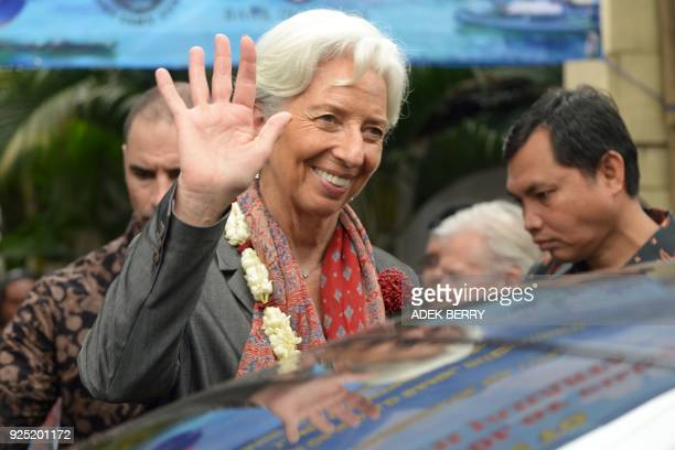 Managing Director of the International Monetary Fund Christine Lagarde waves after a visit in Cilincing Jakarta on February 28 2018 Lagarde visited...